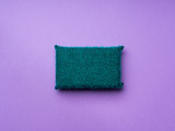 Cleaning sponge on purple background. Minimal cleaning concept - 206956378