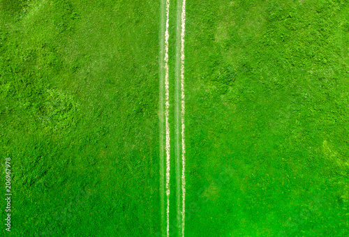 Aluminium Groene aerial view of countryside road in the green summer meadow