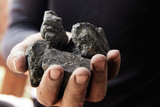 Man hand holding coal. coal mining. - 206983724