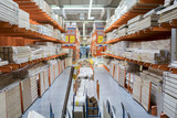 interior of hardware retailer with aisles, shelves, racks of building material insulation floor to ceiling. - 206999398
