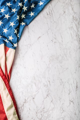 Close-up american flag on white marble background