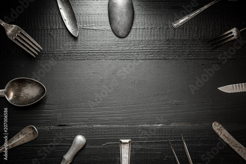 Leinwanddruck Bild Rustic Silverware on Dark Wooden Background. Kitchen and Restaurant Concept.