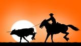 Cowboy ropes a steer - 207038388