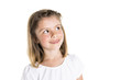 Portrait of a cute 7 years old girl Isolated over white background pensive