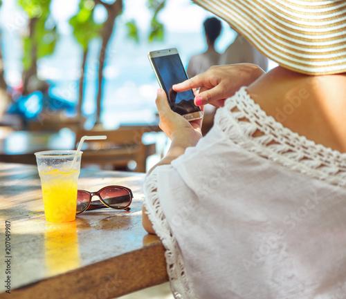 Fotobehang Konrad B. Calm lady relaxing in the beach bar