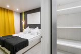 Hotel standart room. modern bedroom with white pillows. simple and stylish interior. interior lighting - 207079596