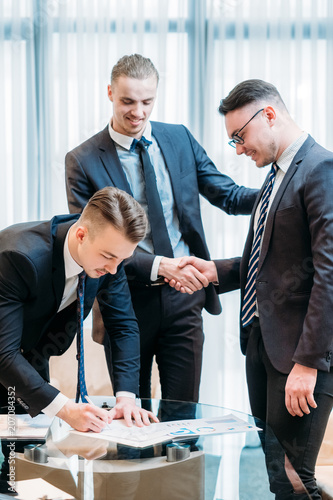 man signing contract closeup. business partnership and cooperation. deal closing and legal documents concept. job promotion, career growth