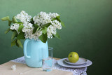 Blooming white lilac in a jug. Still life in rustic style. - 207097951