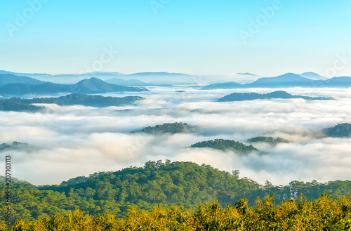 Fotobehang Pool Landscape under morning fog covered the valley like clouds floating in wonderful idyllic highlands of Dalat, Vietnam