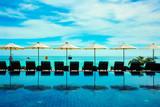 Beach resort umbrella reflect with sea - 207107547
