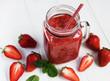 Jar with strawberry smoothie