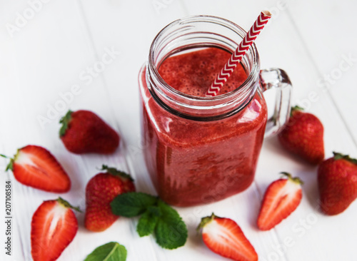 Jar with strawberry smoothie - 207108584