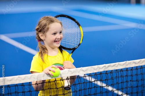 Fotobehang Tennis Child playing tennis on indoor court