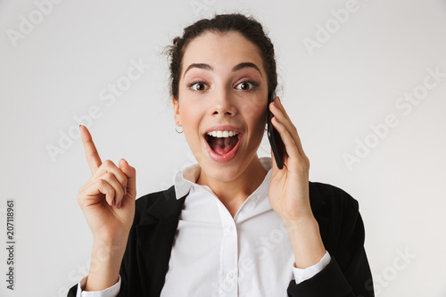 Portrait of an excited young businesswoman