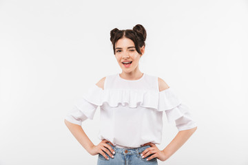 Photo closeup of amusing teenage girl 20s wearing double buns hairstyle and dental braces winking and smiling to you, isolated over white background © Drobot Dean