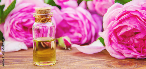Essential oil of rose on a light background. Selective focus.  © yanadjan