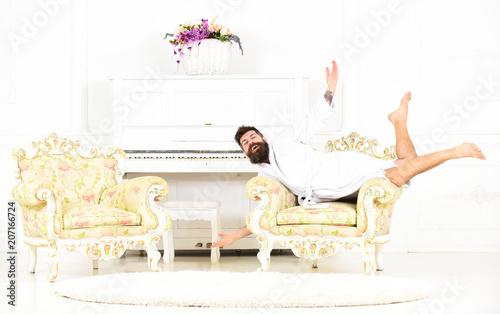 Bon Odd Guy Lying On Antique Furniture. Millionaire In White