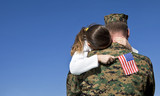 Military Father Hugging His Daughter With An American Flag - 207185162
