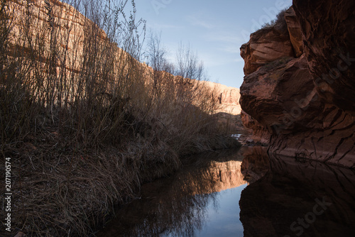 Plexiglas Zwart A reflection in water in a valley in Moab, Utah,