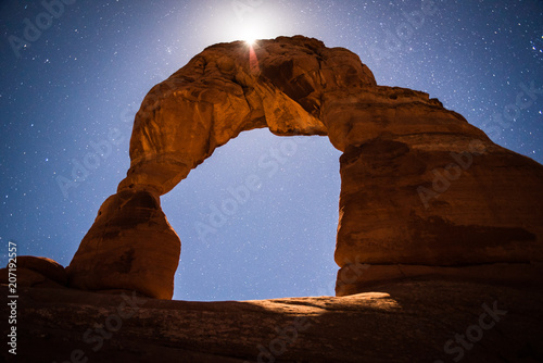 Fotobehang Bruin Delicate Arch in Arches National Park, Utah under the moonlight.