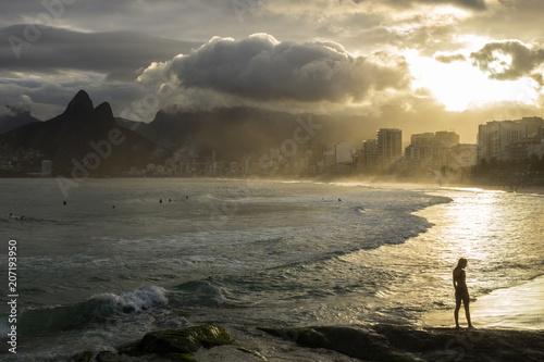 sunset in arpoador beach rio de janeiro brazil