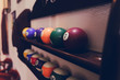 Постер, плакат: Balls for pool billiards on the shelf colored or white balls for billiards on a wooden background