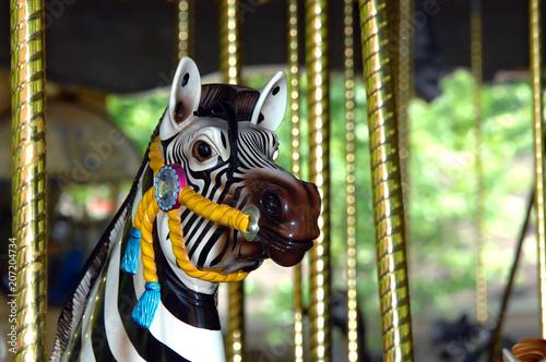 Fotobehang Amusementspark Carousel Zebra on Merry go Round