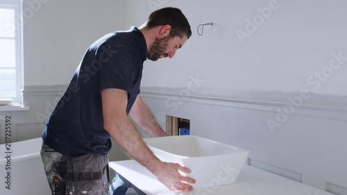 Plumber Fitting New Wash Basin In Bathroom