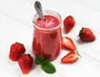 Jar with strawberry smoothie
