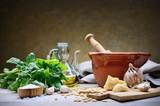 Genoese pesto. Basil pesto with pine nuts, garlic, parmesan cheese and extra virgin olive oil - 207244924