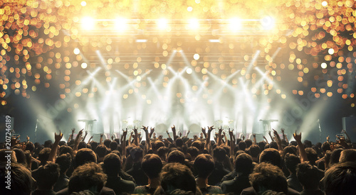 Concert venue crowded with clapping fans. Distress effects and lens flare are visible - 207246189