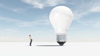 The man looks up towards a big bulb. © Orlando Florin Rosu