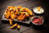 Baked potato fries on wooden table - 207277114