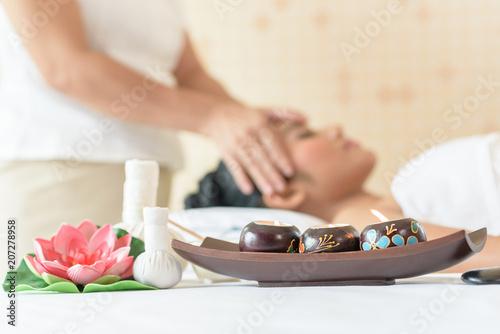 Young asian woman enjoying face massage in luxurious beauty salon. © ic36006