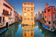 Venice. Cityscape image of narrow canals in Venice during sunset.