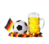 Glass with beer, soccer ball with german flag and flower chain