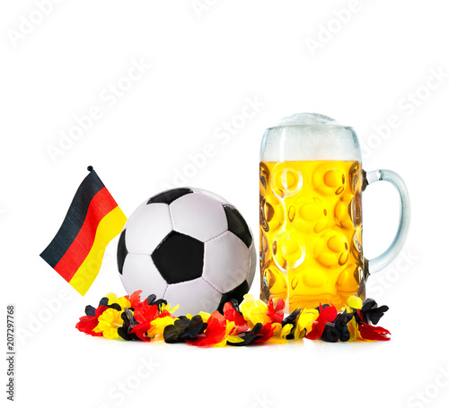 Leinwanddruck Bild Glass with beer, soccer ball with german flag and flower chain