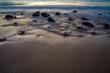 Stones on the sandy beach