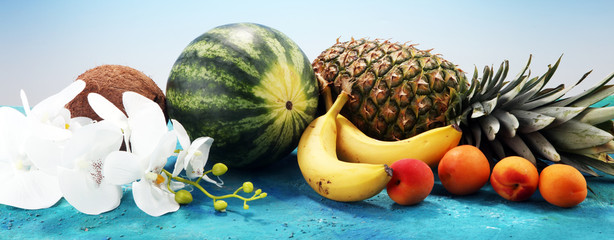 Tropical fruits background with pineapple, banana, coconut and watermelon © beats_