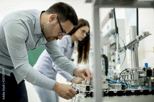 Young couple of students at robotics lab