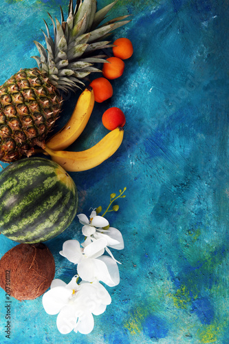 Tropical fruits background with pineapple, banana, coconut and watermelon