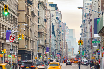 Broadway in New York City with people and cars