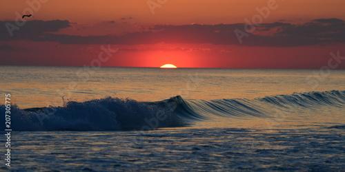 Fotobehang Zee zonsondergang Orange horizon Panama City Beach, Fl