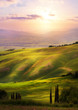 Italy; San Quirico d'Orcia; sunset over Tuscan Valdorcia rolling hills - 207307588