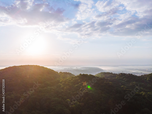 sunrise over mountains. aerial view. new day