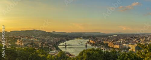 Leinwanddruck Bild View to Budapest skyline form Citadella Hill at sunset