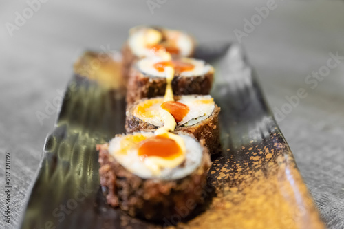 Aluminium Sushi bar Sushi, a typical Japanese food prepared with a base of rice and various raw fish such as tuna, salmon, shrimp and sea bream. To which is added, according to the variants,.