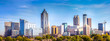 Leinwanddruck Bild - Downtown Atlanta Skyline showing several prominent buildings and hotels under a blue sky.