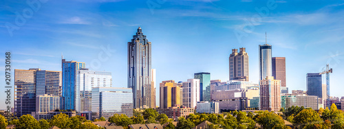 Leinwanddruck Bild Downtown Atlanta Skyline showing several prominent buildings and hotels under a blue sky.