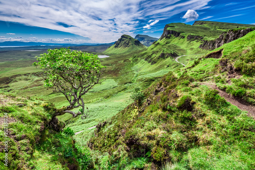 Sunny view to green valley in Quiraing, Scotland, UK
